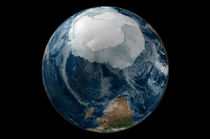 Earth with the full Antarctic region visible. by Stocktrek Images