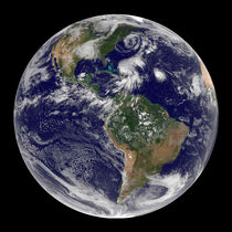 View of the full Earth and four storm systems. by Stocktrek Images