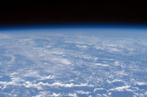An oblique horizon view of the Earth's atmosphere. by Stocktrek Images