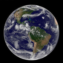 Full Earth showing various tropical storm systems. by Stocktrek Images