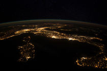 Nighttime panorama showing city lights of Europe. by Stocktrek Images