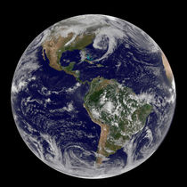View of full Earth showing low pressure systems. by Stocktrek Images