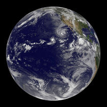 Full Earth showing various tropical storms. by Stocktrek Images