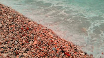 sea waves lapping on the beach of pebbles. by Andrey Lipinskiy