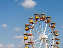Giant Ferris Wheel In Fun Park On Blue Sky by Radu Bercan