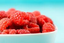 White Bowl Of Red Fresh Raspberries by Radu Bercan
