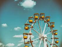 Ferris Wheel In Fun Park On Blue Sky by Radu Bercan