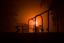 Playground in fogg in autumn