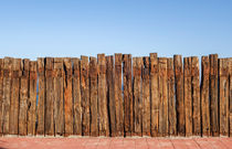 Wooden Fence Blue Sky by Perry  van Munster