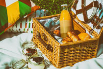 Picnic Basket With Fruits, Orange Juice, Croissants And No Bake Blueberry And Strawberry Jam Cheesecake by Radu Bercan