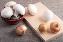 Champignon mushrooms and onions on the table by Vladislav Romensky