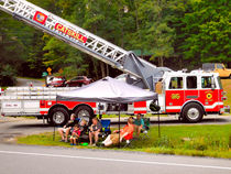 Fire-truck-with-ladder-extended-on-display-1