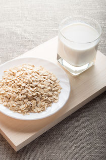 Plate with dry cereal and a glass of milk von Vladislav Romensky