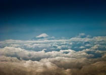 Mount Fuji piercing through clouds by Erik Mugira