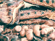 Sausages And Steaks On Barbecue Grill by Radu Bercan