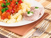 Italian pasta and slices of meat by Vladislav Romensky