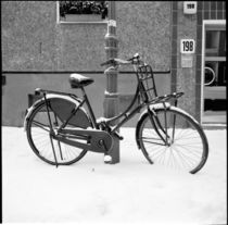 Black bicycle in the snow, Berlin by Ron Greer