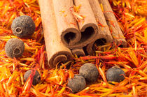 Cinnamon, peppercorn and saffron close-up by Vladislav Romensky