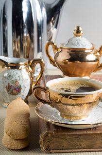 Breakfast in vintage style - espresso and Savoiardi on the table by Vladislav Romensky