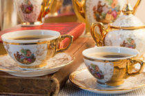 Retro porcelain coffee cups with hot espresso and vintage dishware by Vladislav Romensky