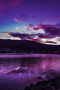 Reflection of purple sky and red clouds across Loch Portree by Bruce Parker