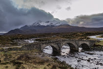 Snowcapped Cuillin Hills over the old bridge at Sligachan by Bruce Parker