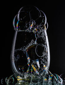 glass with bubbles on black number 2 by Tim Seward