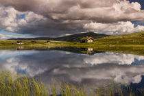 Huts on lake in landscape of Norway by Bastian Linder