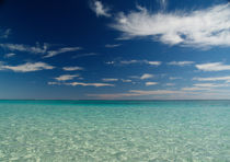 Turquoise Ocean and Blue Sky with white clouds by Bastian Linder