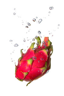Dragon fruit in water with air bubbles by Bastian Linder