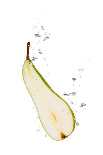 Pear in water with air bubbles by Bastian Linder