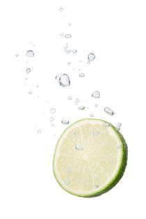 Lime in water with air bubbles by Bastian Linder
