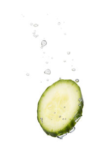Cucumber in water with air bubbles by Bastian Linder