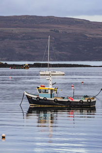 Fishing boat and yacht anchored in Portree Harbour, Isle of Skye, Scotland by Bruce Parker