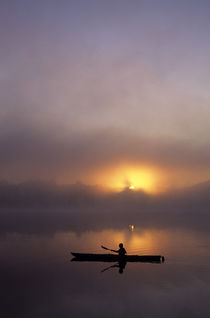 Silhouetted Kayaker Sunrise by Jim Corwin