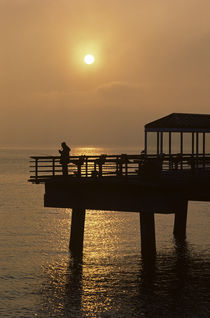 Silhouetted Fisherman at Sunset by Jim Corwin