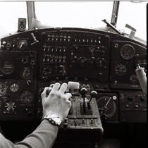 A man at the helm of an old plane by Kiryl Kaveryn