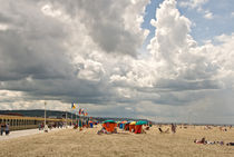 Clouds on the beach by Thierry  Dehesdin