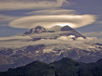 Mount Rainier (volcano) with a glowing lenticular cloud by Ed Book