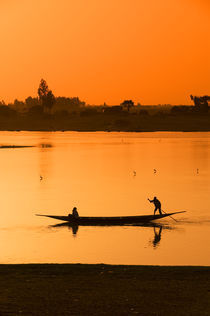 Canoe on Bani River by Wolfgang Kaehler