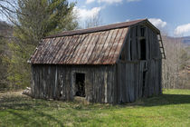 Weathered wooden barn by Carl Tyer