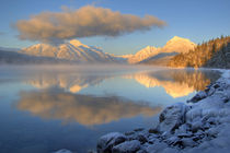 Fog rises from Lake McDonald in Glacier National Park in Montana by Danita Delimont