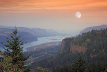 The moon hangs in the sky above the Vista House, Oregon by Danita Delimont