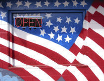 USA, Washington, Moses Lake. Flag wall mural on a business. Credit as by Danita Delimont