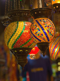 Vendor in Spice Market offerring colorful Stained Glass Lamps, Istanbul Turkey by Danita Delimont