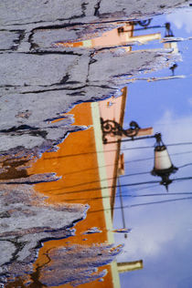 Mexico, San Miguel de Allende, Lantern reflection in puddle. Credit as von Danita Delimont