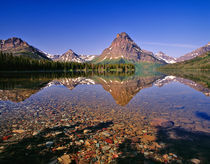 Mountains reflect into calm Two Medicine Lake in Glacier National Park, Montana by Danita Delimont