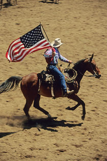 USA flag at rodeo opening ceremony (NO MODEL RELEASE) von Danita Delimont