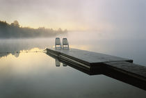 Canada, Ontario, Algonquin Provincial Park, Chairs on dock.   Credit as von Danita Delimont