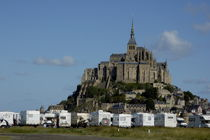 Campervans parked beneath Mont Saint-Michel, France. by Sami Sarkis Photography